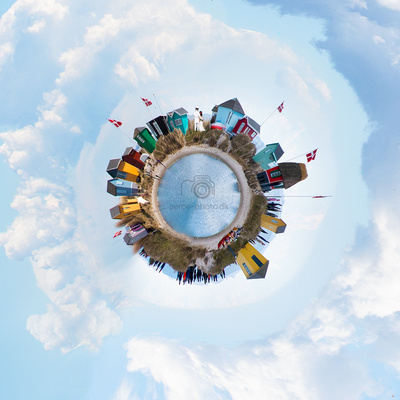 Little planet wedding photo with the colorfull beach huts on the island Ærø.