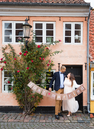 Happy couple with what may be Ærø islands last blooming rose.