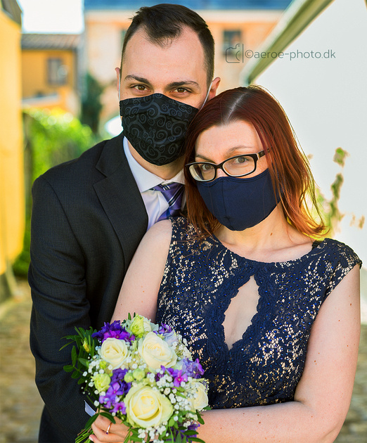 Wedding couple on the island Ærø posing with their matching masks.  The island Ærø is one of the worlds safest places to get married at the moment: we haven't had a single case of Corona virus for 5 months :-)