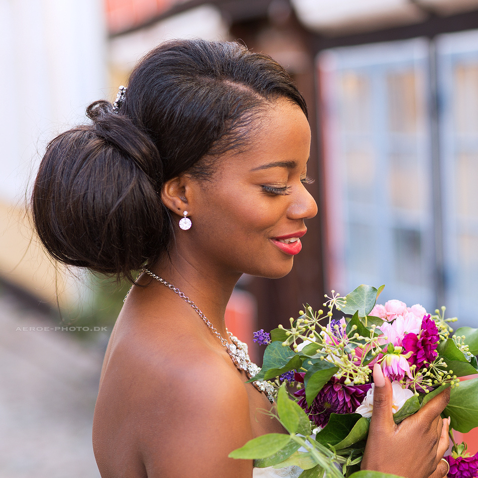 Beautiful bride photographed at her wedding in the streets on the island Aeroe