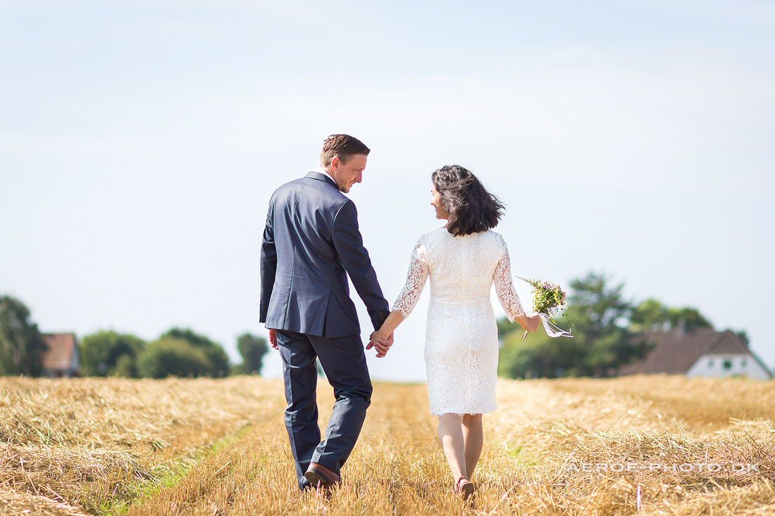Another day in the office with a happy wedding couple in the fields on the island Aeroe.